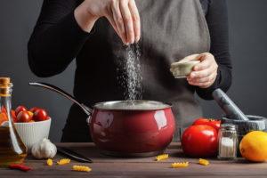 The chef prepares spaghetti and pasta.